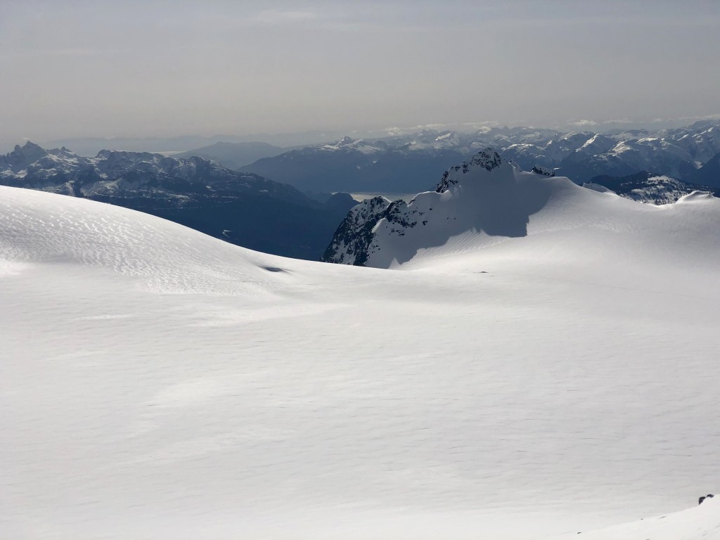 View toward west of Howe Sound, Sunshine Coast and Vancouver Island from the ~2370m summit. You can spot our camp on the icefield.
