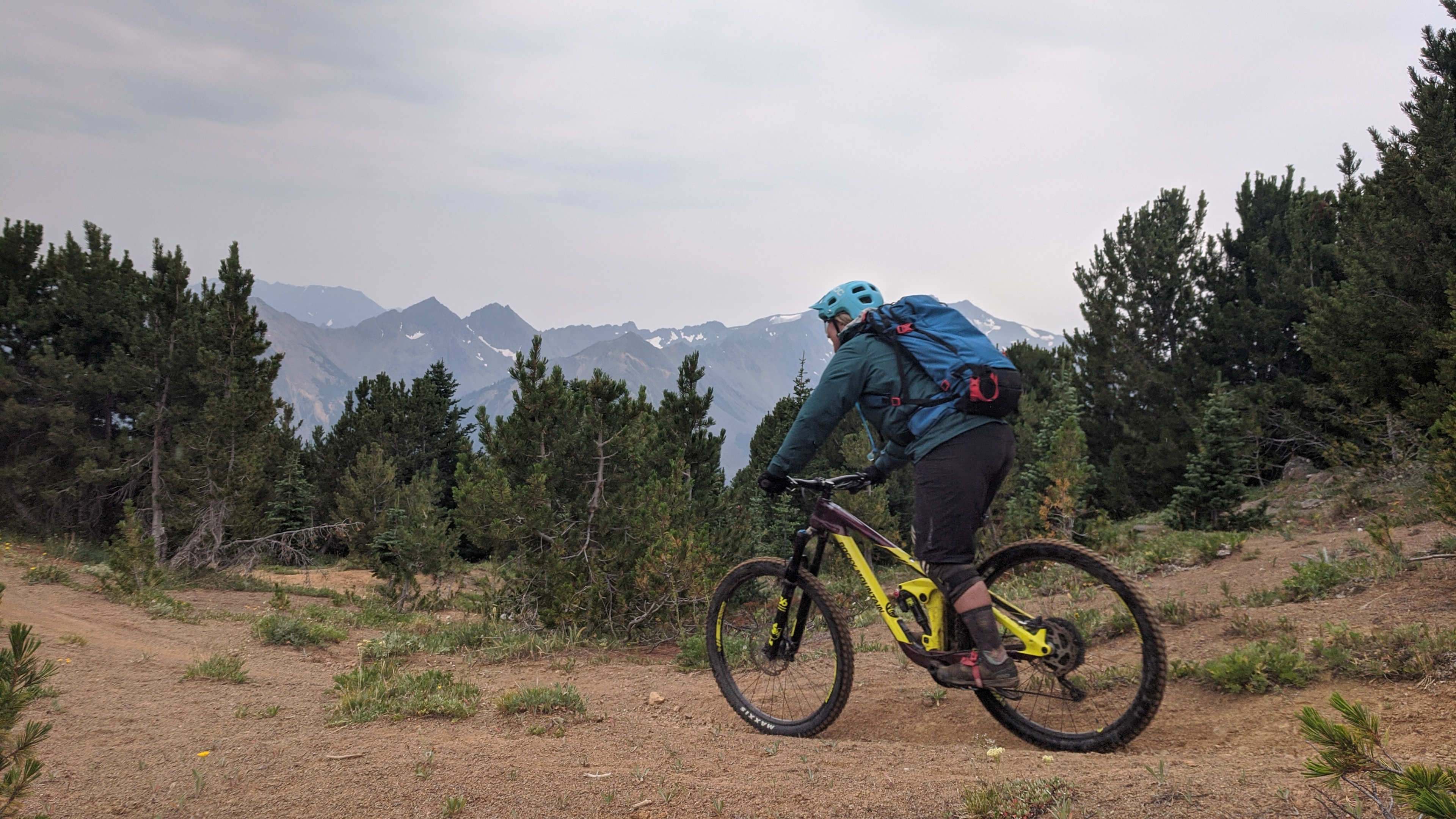 A Tyax group rider shredding the trails near Deer Pass. Photo by Melissa.